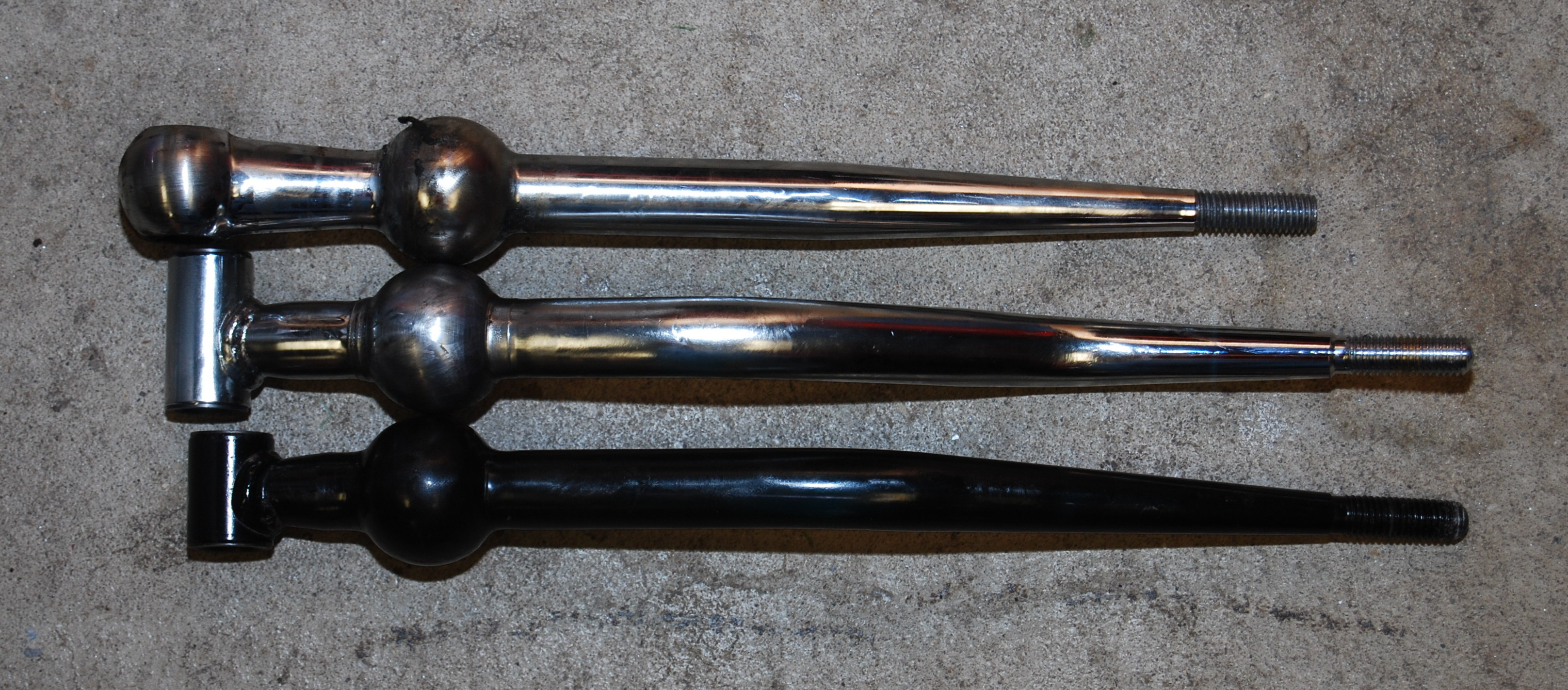 From top to bottom:  B&M, OEM Integra, OEM Civic.  The chromed OEM shifter came in later versions of the Integra.  Earlier versions of the shifter were black.