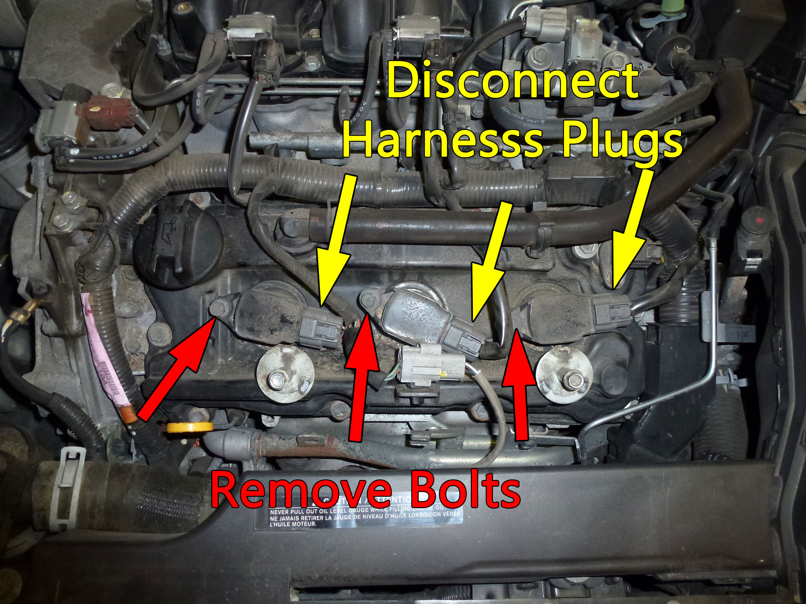 After removing the cover, start by swapping out the front three plugs. Unplug the three harness plugs then remove the bolt that secures the coil to the valve cover.