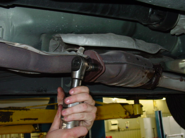 Remove the nuts and bolts that attach the exhaust to the cat. In some cases you may need to remove the cat along with the exhaust to remove all of the bolts (not the case with the 240)