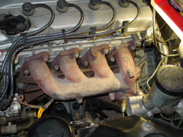 Once the EGR tube is disconnected, you will need to remove all of the exhaust manifold bolts. Do not be alarmed if the stud comes out with the nut.