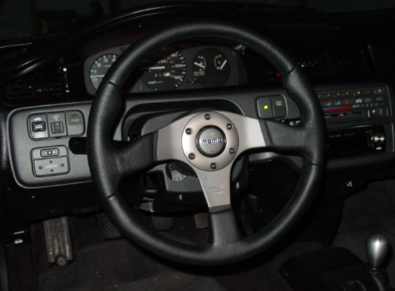 Many may believe the aftermarket steering wheel to be a cosmetic upgrade however the smaller size and drastically reduced weight greatly improves feedback.