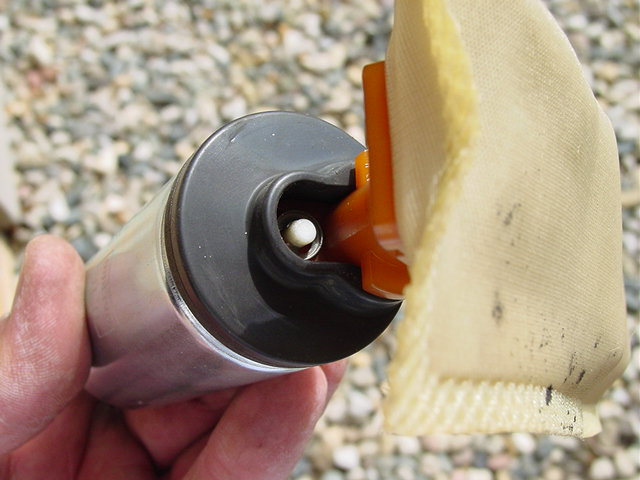 You will need to use a small screwdriver to remove the clip that retains the fuel pump sock. Be careful not to damage this, as you will need to reuse it for the new pump.