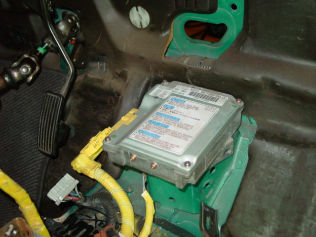 This is the ideal time to remove the airbag harness and computer. The computer is located in the center of the car near the firewall. You will need a torx bit to remove the computer.
