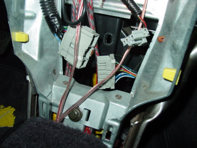 Once you have the console out of the way, you will see a large harness plug. This is the wiring for the climate control. It needs to be disconnected just as I've shown in the picture.