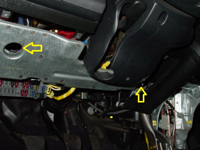 Remove the plastic cover under the steering column by removing three screws, two on the left and one on the right.