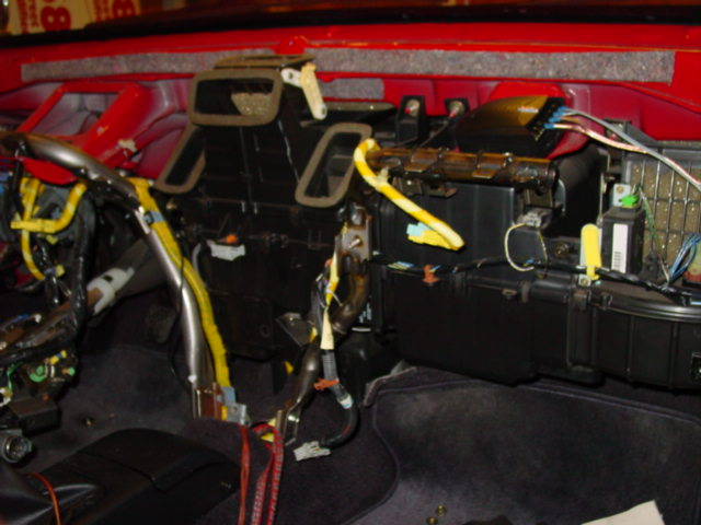 The yellow harness is the airbag harness. You will need it to get the horn and cruise control to work.