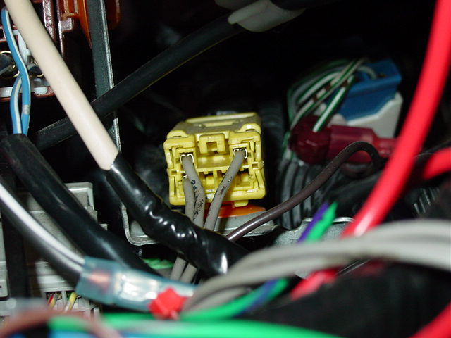 The yellow airbag harness attaches to a plug found on top of the fuse panel.
