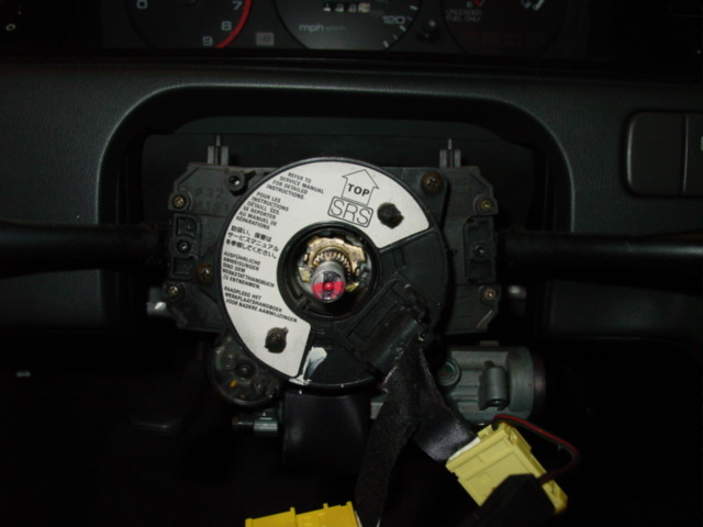Remove the steering column cover by pulling out three screws located on the bottom.