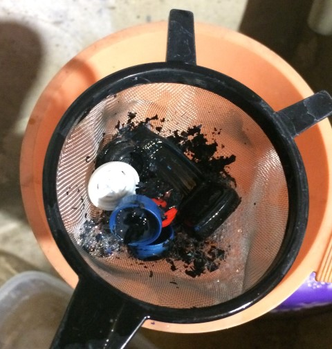 The strainer is great for catching smaller pieces when pouring the degreaser back into the container.